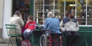 People in front of a cafe